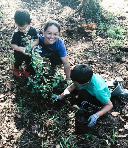 children and mother planting